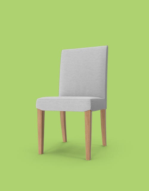 Grey chair on a green background with wooden legs