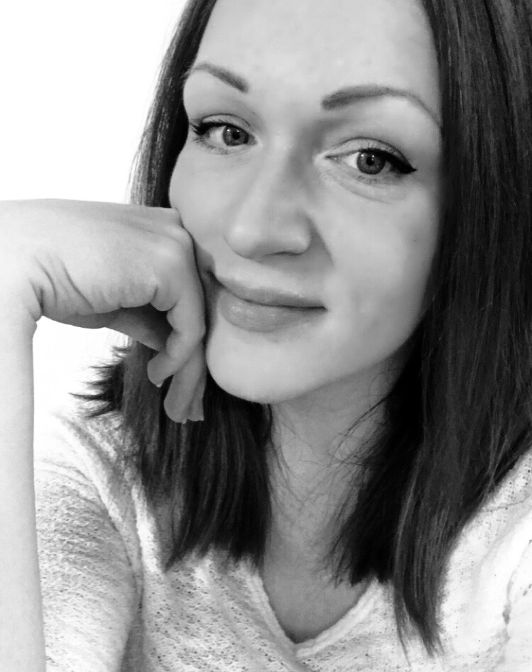Black and white photo of Marketing Specialist, Lyndsay Therrien.