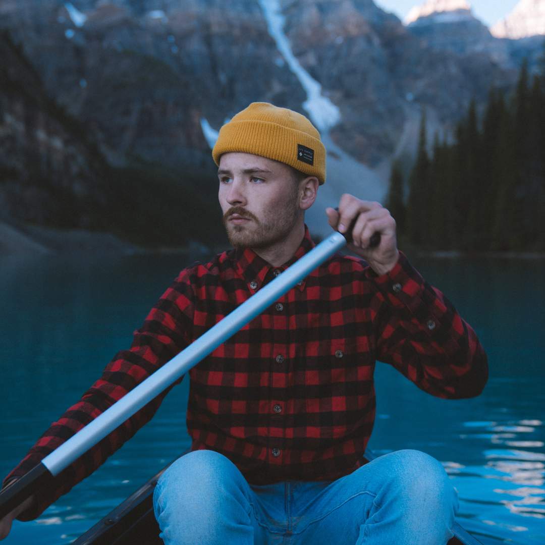 Photographer and Social Media Coordinator, Bryce Byrnes paddling in a canoe.