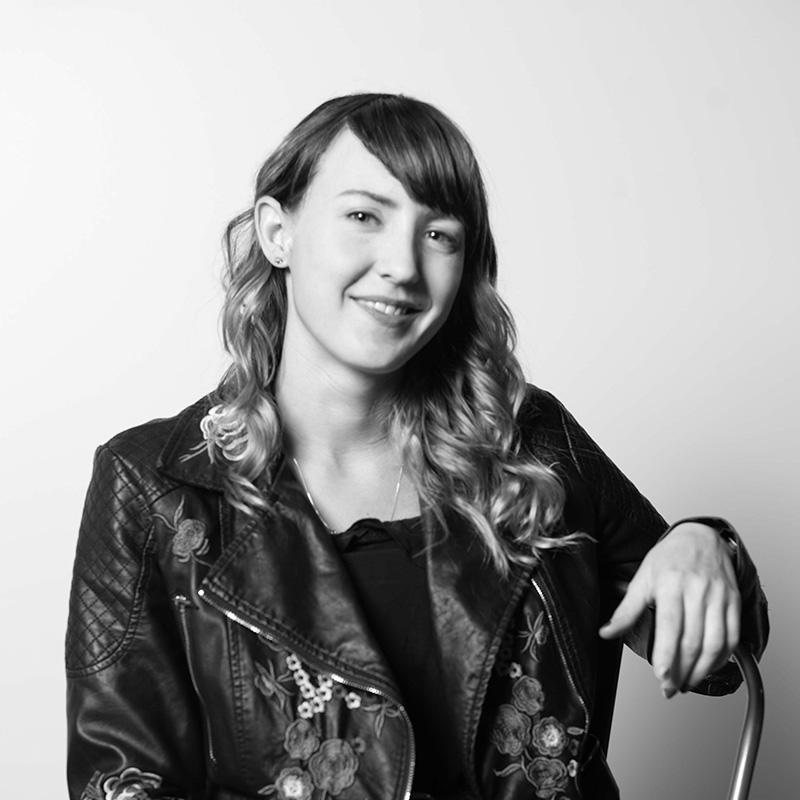 Black and white headshot of Nicole Redmond, Art Director at Twirling Umbrellas.