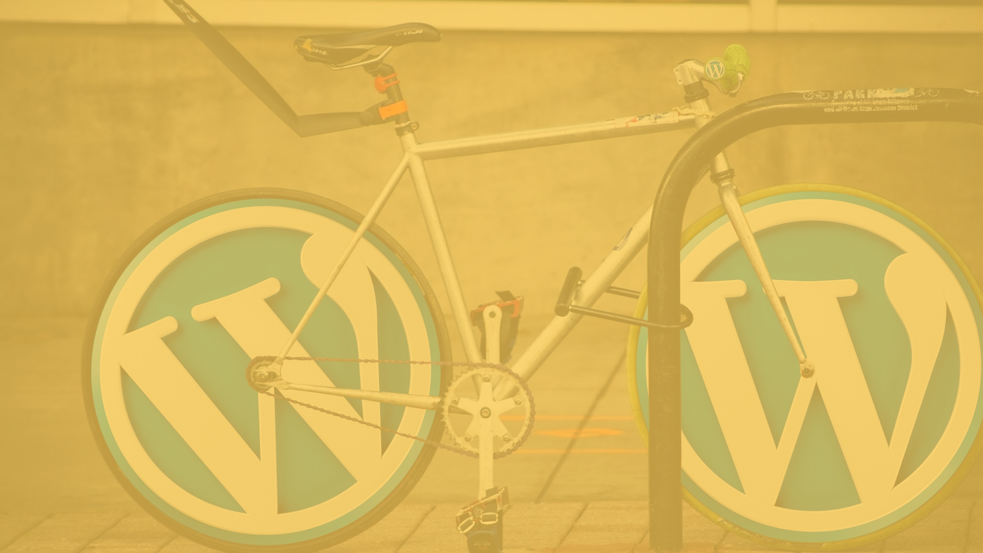 bicycle with the Wordpress logo used to replace the tires. Image is a yellow overlay colour