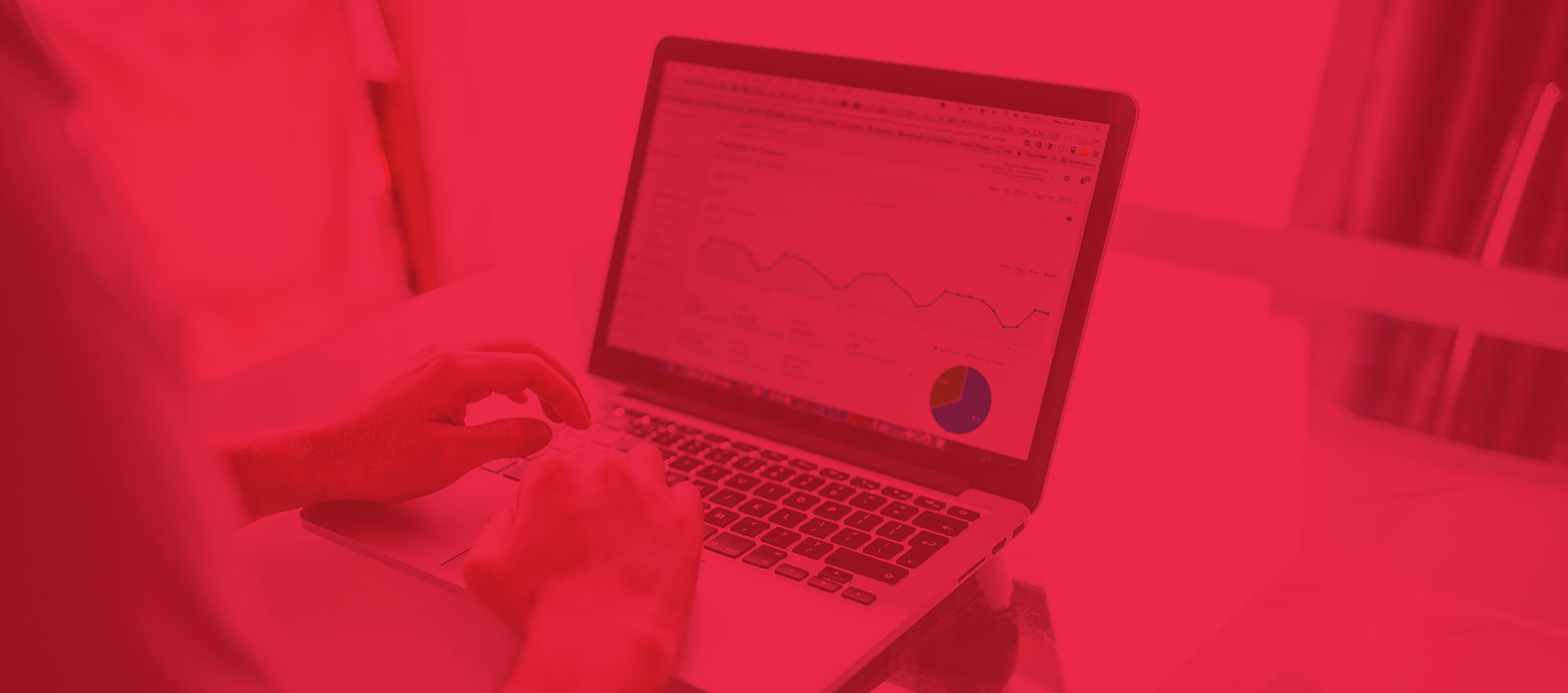 Search Engine Marketing Header; featuring a user on a laptop with SEO analytics stats on the screen and a red overlay