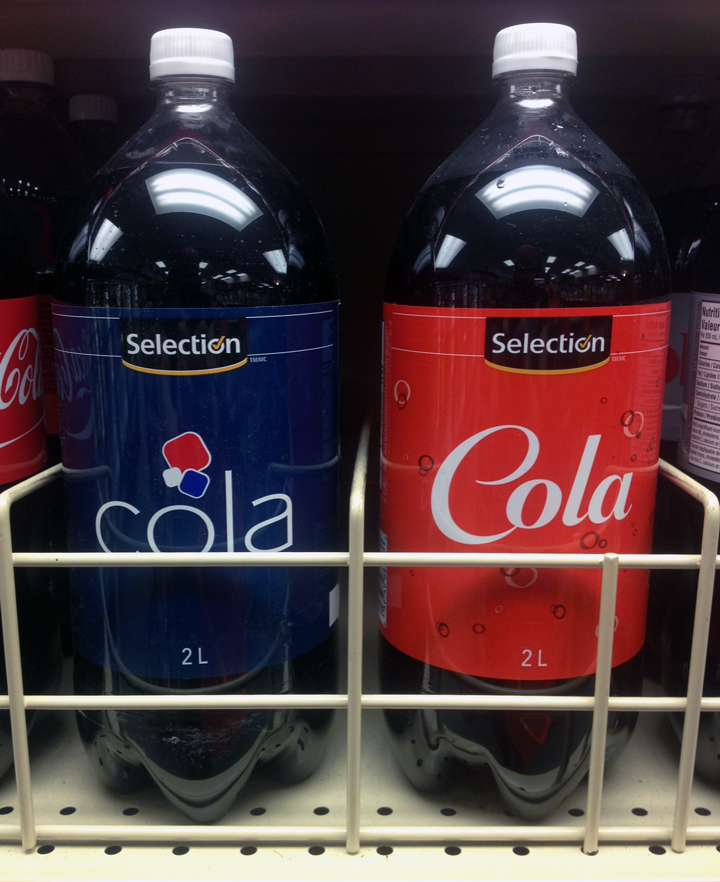 Two bottles of Selection brand Cola, one bottle mimics Pepsi's branding and one mimics Coca Cola.